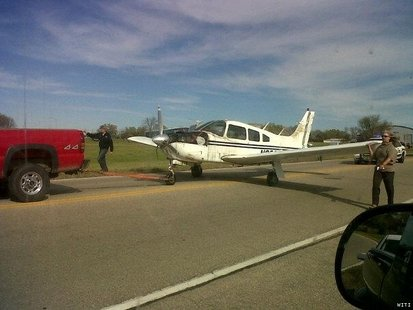 A small single engine plane lands on 12th Street in Watertown.  (Photo courtesy of Fox 6 WITI- TV)