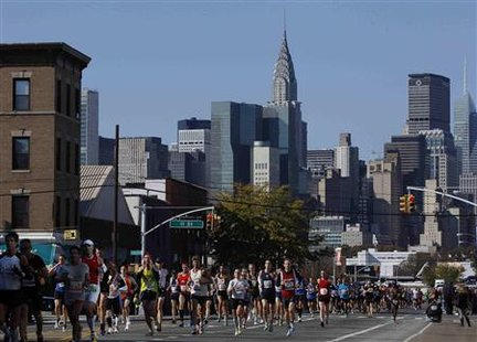 Runners make their way through the borough of Queens during the 2011 New York City Marathon in New York