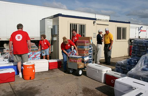 Greensburg, KS, May 29, 2007 -- The Salvation Army moving its entire food and beverage facilities to make room for modular offices needed to manage recovery operations. The move to a nearby site was accomplished by their staff, volunteers, and other relief workers . Photo by Greg Henshall / FEMA By Greg Henshall (This image is from the FEMA Photo Library.) [Public domain], via Wikimedia Commons