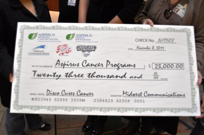 WIFC presents a check for $23,000 to Aspirus Cancer Care.