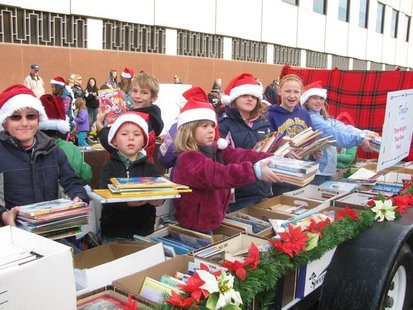 Kids hands out books at the 2010 Kalamazoo Holiday Parade.