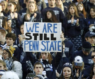 Penn State football fans look on after their loss in an NCAA football game against Nebraska in State College