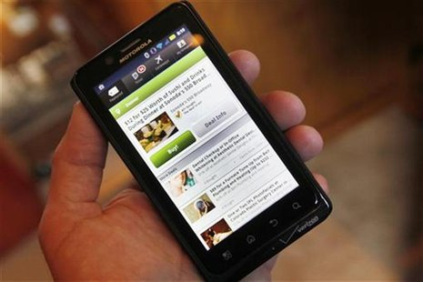 The Groupon smartphone app is seen on a Motorola Droid Bionic cellphone in Denver