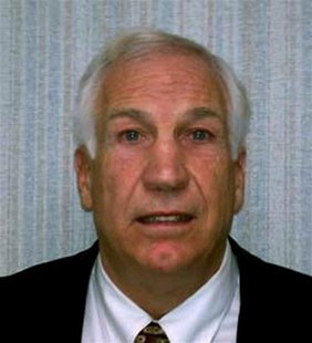 Former Penn State football Defensive Coordinator Sandusky is pictured in police photograph