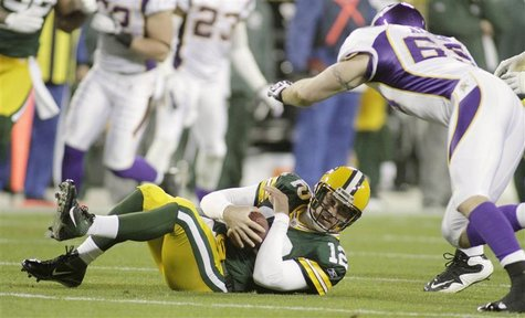 Green Bay Packers' starting quarterback Rodgers dives on his own fumbled ball during NFL game in Green Bay