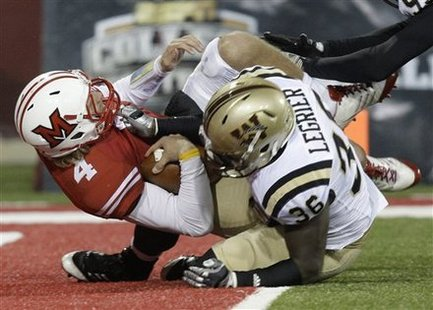 Miami (Ohio) quarterback Zac Dysert (4) is sacked near the goal line by Western Michigan defensive end Deauntay Legrier (36) in the second half of an NCAA college football game Wednesday, Nov. 16, 2011, in Oxford, Ohio. Western Michigan won 24-21.
