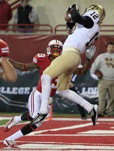 Western Michigan receiver Robert Arnheim (12) catches the go-ahead 2-yard touchdown pass against Miami (Ohio) cornerback Trey Payne (23) in the second half of an NCAA college football game Wednesday, Nov. 16, 2011, in Oxford, Ohio. Western Michigan won 24-21.