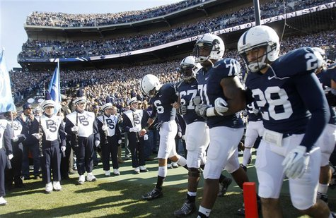 Penn State football players Derek Moye, Quinn Barham, Devon Still, and Drew Astorino enter the field prior to their NCAA football game again