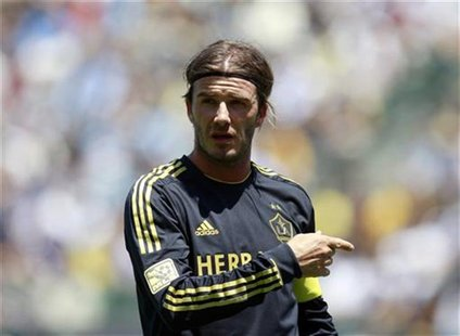 Los Angeles Galaxy's David Beckham protests a call during their World Football Challenge soccer match against Manchester City in Carson