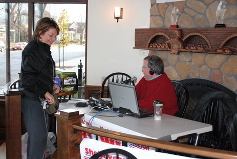 A Sheboygan woman drops of toys during the Jerry Bader show Friday morning.