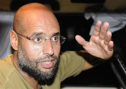 File picture shows Saif Al-Islam, son of then Libyan leader Muammar Gaddafi, gesturing as he talks to reporters in Tripoli