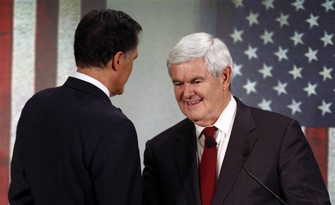 Republican presidential candidate former House of Representatives Speaker Newt Gingrich (R) shakes hands with former Massachusetts Governor