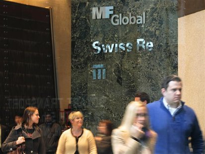 People walk through the office complex where MF Global Holdings Ltd have an office on 52nd Street in midtown Manhattan New York