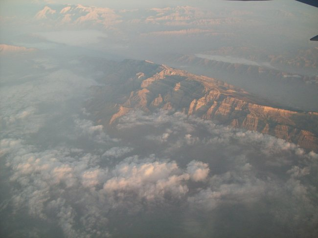 View of Afghan mountains flying into the country.