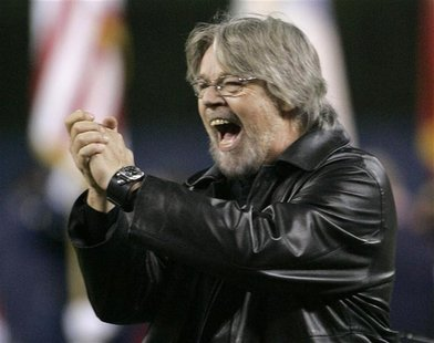 Singer Bob Seger reacts after performig America the Beautiful before Game 1 in Major League Baseball's World Series in Detroit