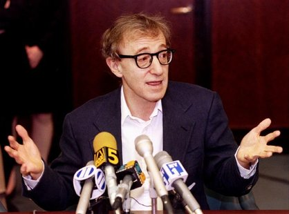 Film director Woody Allen reacts during a press conference in New York June 7, after estranged lover..