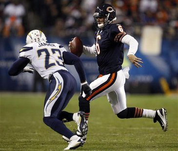 Bears quarterback Cutler is chased out of bounds by San Diego Chargers' Jammer in their NFL football game in Chicago