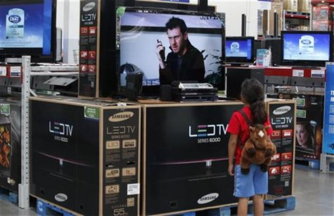 A child looks at a flat screen television at a Sam's Club, a division of Wal-Mart stores in Bentonville
