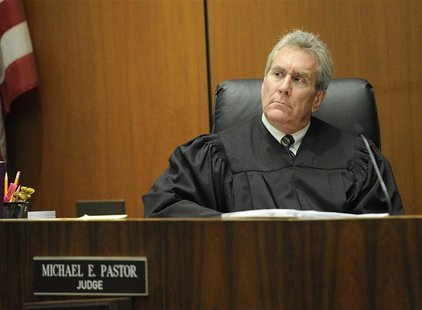 Judge Michael Pastor listens during the redirect cross-examination of Dr. Paul White in Dr. Conrad Murray's trial in the death of pop star M