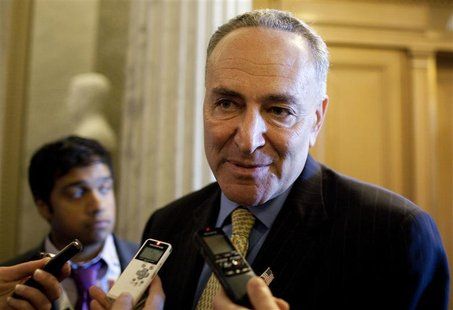 Senator Schumer (D-NY) speaks to the media before voting on a bill allowing a rise in the debt ceiling on Capitol Hill