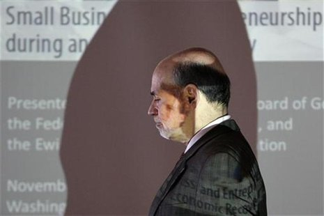 Federal Reserve Chairman Ben Bernanke is pictured in front of a projection screen after delivering opening remarks at a conference in Washin