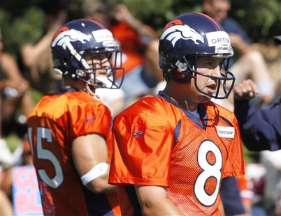 Denver Broncos NFL football starting quarterback Kyle Orton and second year quarterback Tim Tebow at the team's first practice in Denver