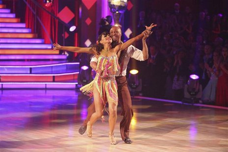 "Publicity photograph of Martinez and Smirnoff performing samba on television show ""Dancing with the Stars"""