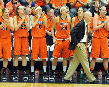 Hope College Women's Basketball Coach Brian Morehouse paces in front of his players while watching game action at DeVos Fieldhouse in Holland. (photo courtesy Hope College)