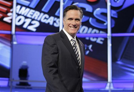 Republican presidential candidate former Massachusetts Governor Mitt Romney takes the stage at the start of the CNN GOP National Security de