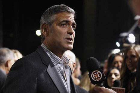 "Clooney is interviewed at the premiere of ""The Descendants"" at the Samuel Goldwyn Theater in Beverly Hills"