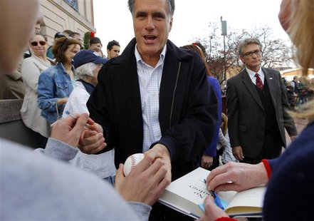 Republican presidential candidate and former Massachusetts Governor Mitt Romney greets supporters at a campaign rally in Nashua