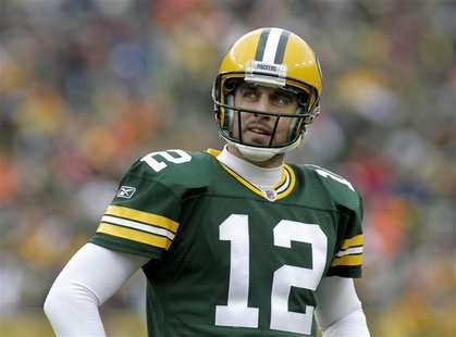 Green Bay Packers' Aaron Rodgers checks the clock against the Tampa Bay Buccaneers in the second half during their NFL football game in Gree