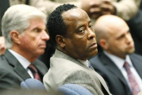 Dr. Conrad Murray remains expressionless next to J. Michael Flanagan after the jury returned with a guilty verdict in his involuntary mansla