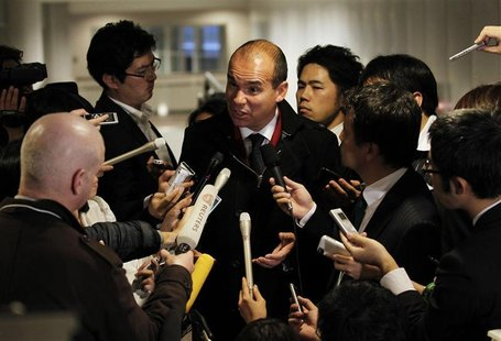 Former CEO of Olympus Corp Woodford speaks to reporters upon his arrival at Narita International Airport