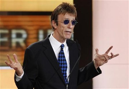 British musician Robin Gibb prepares to present U.S.actor John Travolta the award for best international actor during Golden Camera awards i
