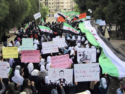Demonstrators march against Syria's President Bashar al-Assad in Homs