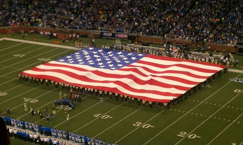 The American flag is spread across the turf at Ford Field in Detroit before the Lions-Packers game on Thursday November 24th, 2011.