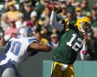 CAN THEY MAKE HIM DO THIS AT HOME? Green Bay Packers quarterback Aaron Rodgers fumbles as he is hit by Detroit Lions defensive tackle Ndamukong Suh in the third quarter of last year's game at Lambeau Field in Green Bay. REUTERS/Allen Fredrickson