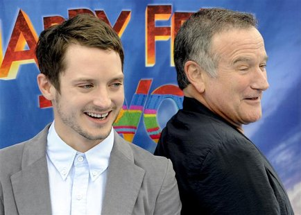 "Elijah Wood and Robin Williams arrive at the premiere of ""Happy Feet Two"" in the Hollywood area of Los Angeles"