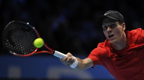 Berdych of the Czech Republic hits a return to Ferrer of Spain during their singles tennis match at the ATP World Tour Finals in London