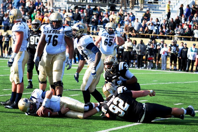 Western Michigan closes out the regular season at home with a 68-19 win over Akron.  Photos by Sean Patrick Duross.