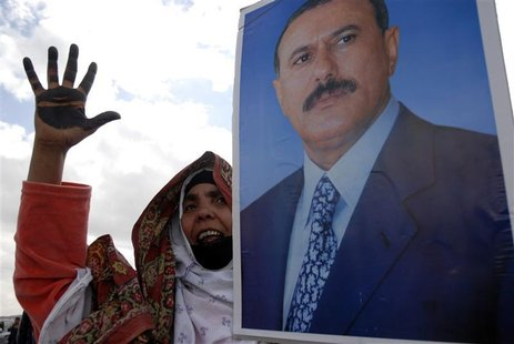A woman holding a poster of Yemen's President Ali Abdullah Saleh takes part in a rally to show support for Saleh during Friday prayers in Sa