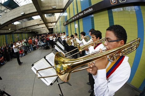 Children play music inside a subway station in Caracas
