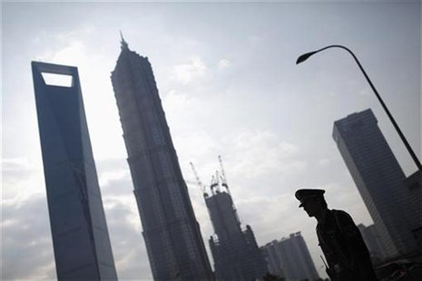 A security guard stands in the financial district of Pudong in Shanghai