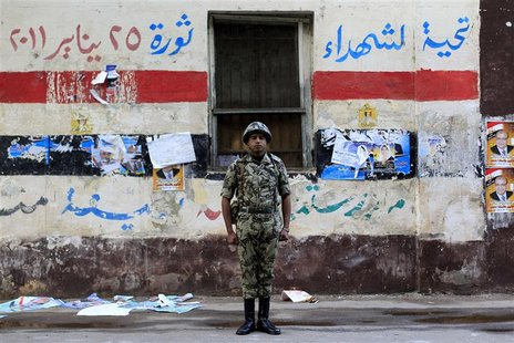 An Egyptian soldier stands guard in front of a polling station in Cairo.