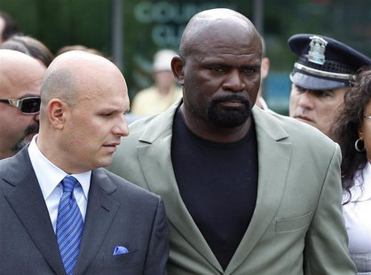 Former NFL football player Lawrence Taylor leaves Rockland County Court after pleading not guilty to third-degree rape charges after his arr