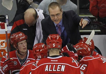 Carolina Hurricanes' head coach Maurice coaches his team during their NHL hockey game against the Toronto Maple Leafs in Raleigh, North Caro