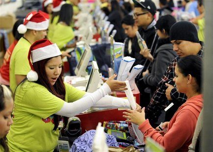 "Shoppers pay for their purchases at an Old Navy store as ""Black Friday"" shoppers get an early start at the Citadel outlet stores on Thanksgi"