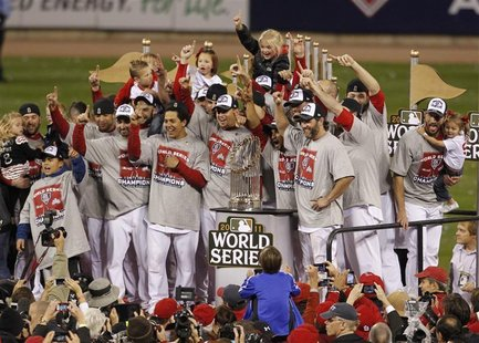 St. Louis Cardinals players celebrate wth the World Series trophy after they defeated the Texas Rangers in Game 7 to win MLB's World Series