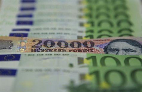 An illustration picture shows a 20000 Hungarian Forint banknote among 100 Euro banknotes in OTP bank in Budapest